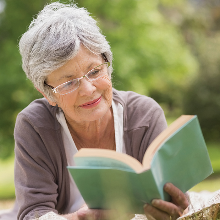 Woman reading outside - ACOYA Mesa - Assisted Senior Living in Arizona